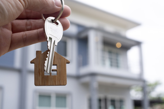 landlord-unlocks-house-key-new-home-real-estate-agents-sales-agents_112699-358